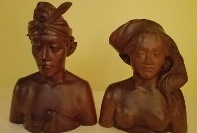 pair of carved wooden figures