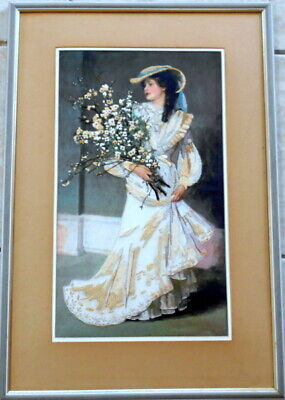 Framed needlepoint on canvas of a lady with flowers