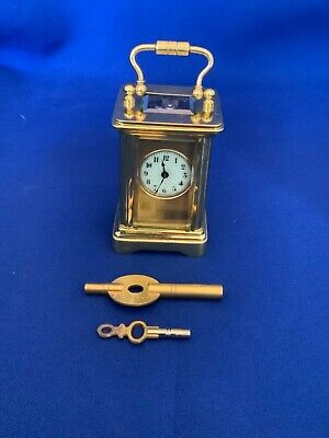 Miniature brass 8 day carriage clock