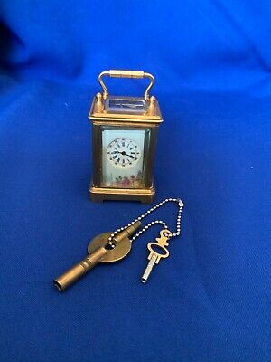brass and enamel miniature 8 day carriage clock