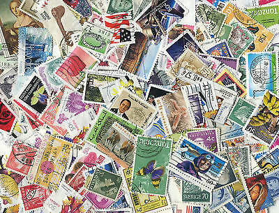 300 world stamps - no GB - off paper - from charity kiloware & old collections