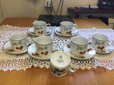 Royal Worcester Evesham vale  cups and saucers. 7 cups 6 saucers