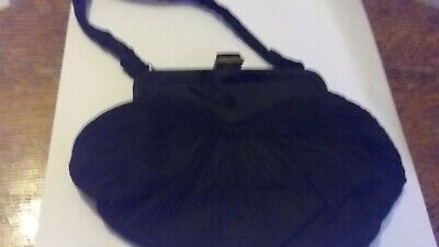 Vintage. Purse silky pleted material..black ...separate purse