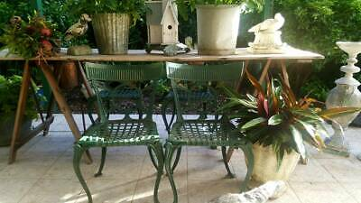 Set of 4 very heavy cast iron garden chairs c1920