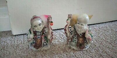 pair of collectable  Chinese long life man and lady figures