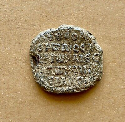 Byzantine lead seal of Theodore imperial ostiarios and in charge of the Oikiakon