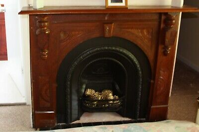 Cast Iron Fireplace Insert with carved wooden mantle