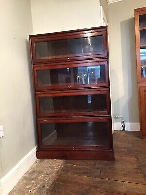 Vintage French Mid Century Glazed Bookcase. Similar to a Globe Wernicke