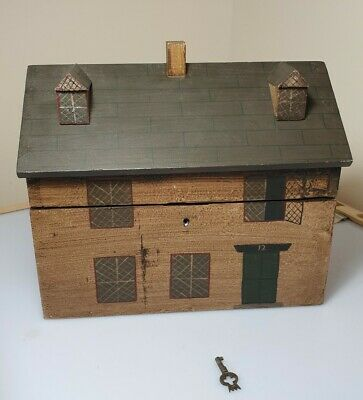 A Rare Folk Art Tea Caddy In The Form Of A Country Cottage With Key.