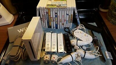 Used Nintendo Wii Console Lot with 18 GAMES with 4 OEM controllers w/ Extras LOT