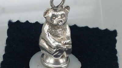 A 1912 Miniature silver teddy bear pin cushion a felt pin cushion