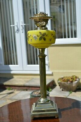 Vic/Edwardian twin burner oil lamp .yellow floral font good condition