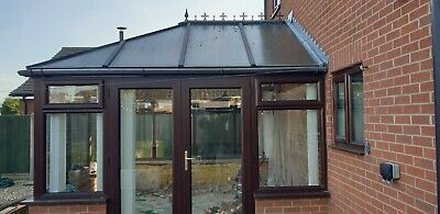 Used brown upvc conservatory