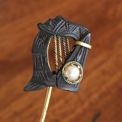 An Antique Late Victorian Carved Irish Bog Oak Harp Stick Pin With Pearl Detail.