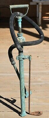 Vintage copper orchard sprayer with rubber hose marked with RECA and a D.