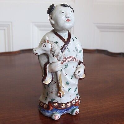 Antique Chinese Porcelain Figure Of A Young Boy Holding A Toy Hobby Horse. 20cm.