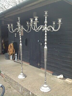 TWO SILVER COLOURED CANDELABRA. Freestanding. 6 Feet Tall. Need Polishing