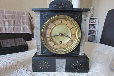 Mantle Clock in a marble/slate case with crossed arrows