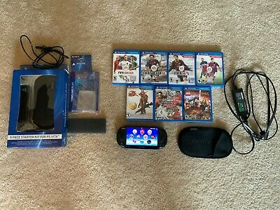 PS Vita + Accessories and 9 Games. Near Mint Console WORKS AND TESTED