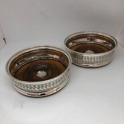 A Pair Of Silver Coasters