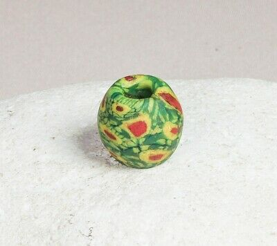 Exceptional ancient Islamic glass bead