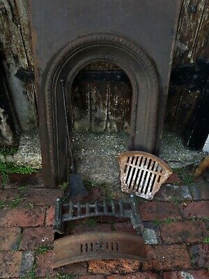 Salvaged cast iron fireplace insert with accessories