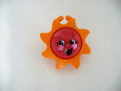 Orange Plastic Sun with Red and Yellow Happy Faces Baby Rattle (USED)