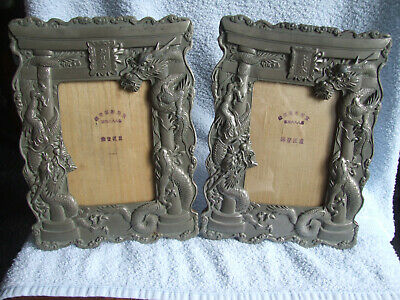 Pair Chinese Mid XX Century White Metal Photograph Frames, cast with dragons
