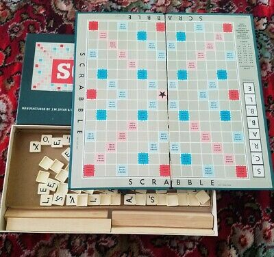 Scrabble board game board slightly damaged. Used condition.