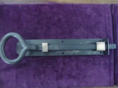 Superb very heavy duty iron and bronze door bolt with inset keep
