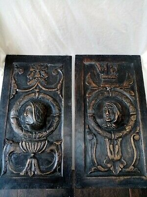 pair of romayne style portrait panels antique carved profile green man