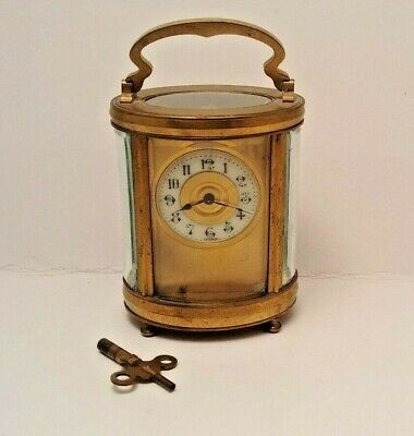 Antique French Bronze  Carriage Clock. Oval Style / Curved & Beveled Glass LION