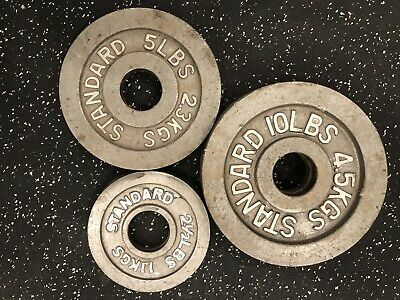 Standard Olympic Weights | (2) 10LBS  (2) 5LBS (2) 2 1/2LBS Plates.