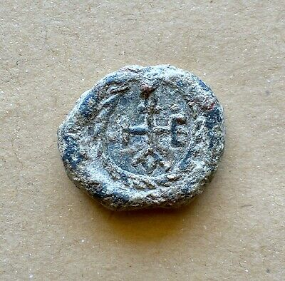 BYZANTINE LEAD SEAL WITH CRUCIFORM MONOGRAM IN EITHER SIDE (6th/7th cent.).Rare!