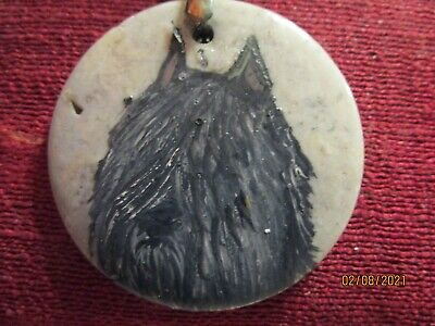 Bouvier des Flandres has been hand-painted on a round grey pendant/bead/
