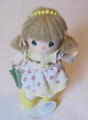 """limited edition PRECIOUS MOMENTS DOLL """"songs of love""""."""