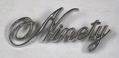 "1974 to 1975 Oldsmobile NOS ""Ninety"" Trunk Lid Emblem"