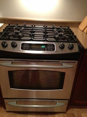 Top of the line GE Profile gas stove with convection oven