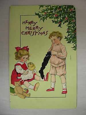 VINTAGE EMBOSSED TUCK'S CHRISTMAS POSTCARD CHILDREN W/ CHRISTMAS GIFTS 1912