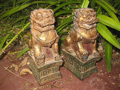 Chinese gilded iron cast pair of Foo Dogs, Ming/Qing dynasty(?)