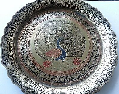 Antique solid brass coloured enamelled plate decorative peacock in centre