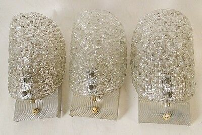 Antique three silverplated metal and solid glass sconces