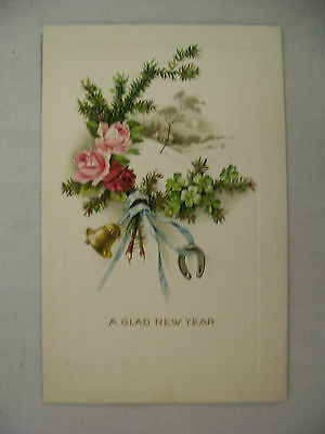 VINTAGE EMBOSSED NEW YEAR POSTCARD SNOWY COUNTRY SCENE WITH FLOWERS UNMAILED