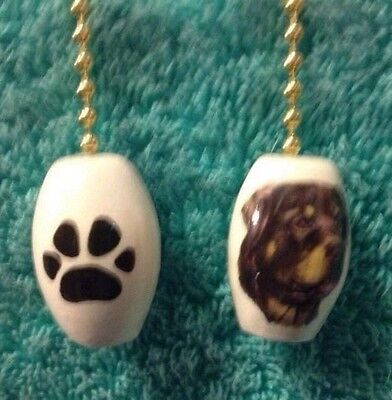 One Rottweiler Dog Fan Pull With Paw Prints On The Back 1""