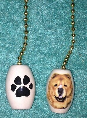 One Chow Chow Dogs Fan Pull With A Paw Print On The Back 1""