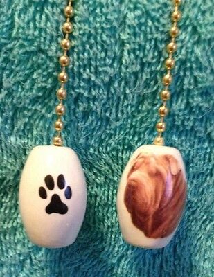 One Shar Pei Dog Fan Pull With A Paw Print On The Back 1""