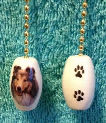"""One Sheltie Dog Fan Pull With Paw Prints On The Back 1"""""""
