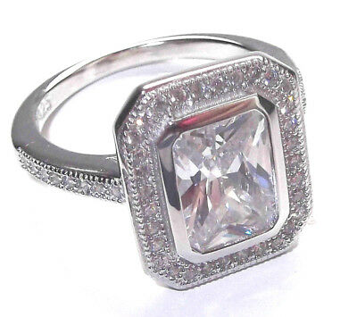 Rhodium Plated 925 Hallmarked Sterling Silver Emerald Cut Rubover Set Halo Ring