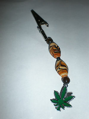 Glass round and flat oval brown design beaded alligator clip w/leaf