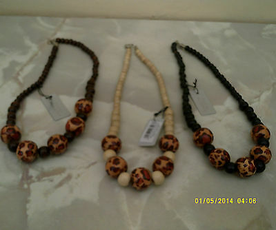 "wooden necklace  in 3 colours size 18"" with pattern on beads"